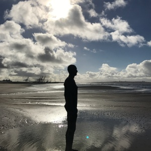A statue (Iron Man) on Crosby Beach.